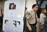 FILE - In this Saturday, May 24, 2014 file photo, Santa Barbara County Sheriff Bill Brown, right, walks past a board displaying photos of suspected gunman Elliot Rodger and the weapons he used in a mass shooting in Isla Vista, Calif., after a news conference in Santa Barbara, Calif. Sheriff's officials say Rodger, 22, went on a rampage near the University of California, Santa Barbara, stabbing three people to death at his apartment before shooting and killing three more in a crime spree through a nearby neighborhood. (AP Photo/Jae C. Hong)