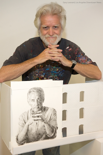 Muralist Kent Twitchell with the mural he plans to paint of artist Ed Ruscha on a building in downtown Los Angeles.
