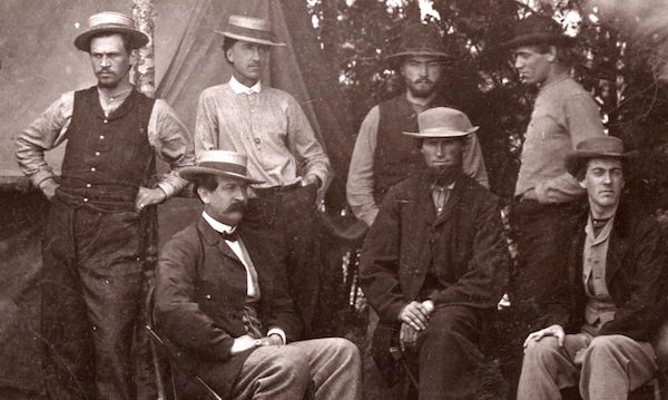 Thomas T. Eckert, seated left, with six telegraph assistants near Petersburg, Virginia, 1864. From James E. Taylor Collection: Scrapbook Two.