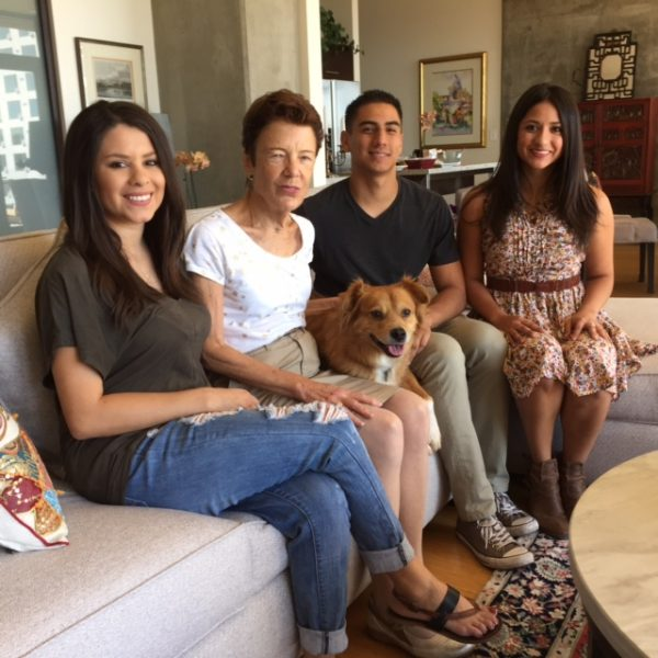 Billie, second from the left, with neighbors and dog in her apartment.