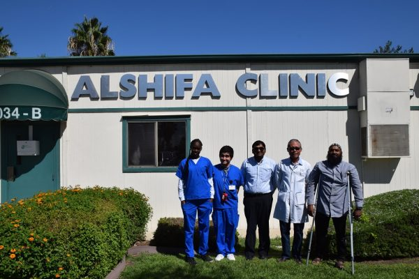 Staff and volunteers outside the Al-Shifa Clinic.