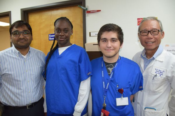 From left to right: Al-Shifa manager Muhammad Safwatullah, Job Corps interns Keviana Mims and Alex Acuna, and Dr. Duc Nguyen at Al-Shifa Free Health Clinic.
