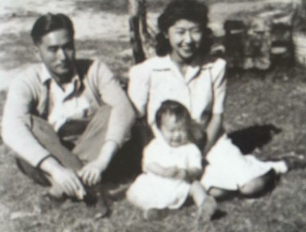 Author's oldest uncle with his wife and first child at the Gila River Internment Camp.