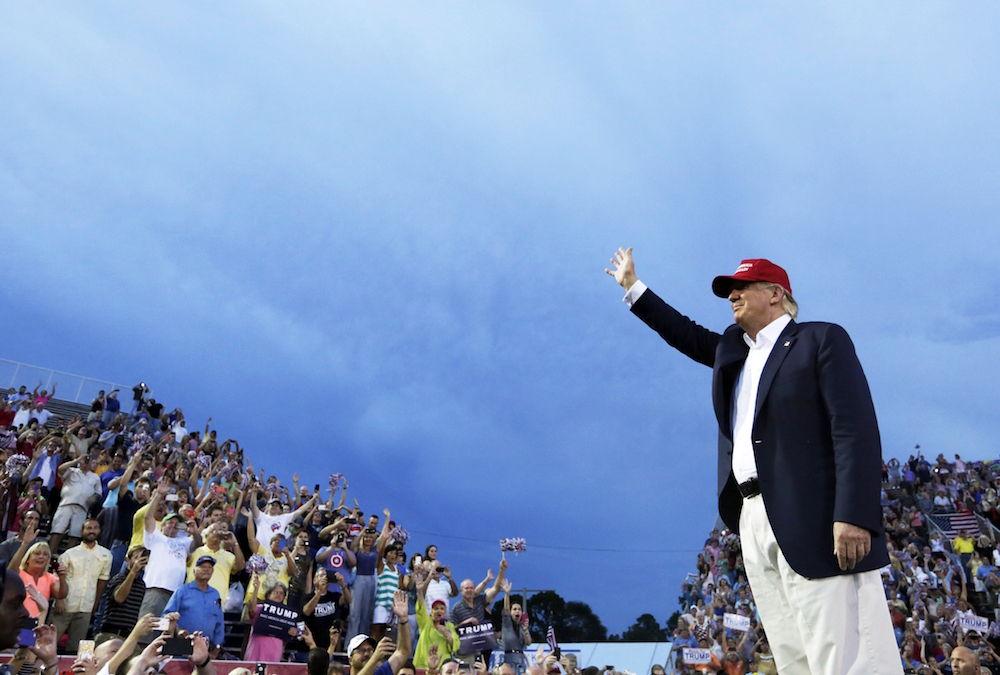 "FILE - In this Aug. 21, 2015 file photo, Republican presidential candidate Donald Trump speaks during a campaign pep rally in Mobile, Ala. NBC's ""Meet the Press"" had its biggest audience in more than a year for its Trump interview on Aug. 16, leading that show's biggest competitors, ABC's ""This Week"" and CBS' ""Face the Nation,"" to feature phone interviews with the New York businessman this past Sunday.  (AP Photo/Brynn Anderson, File)"