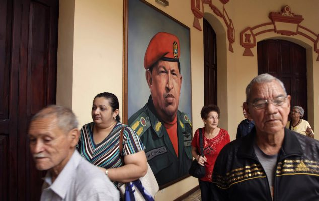 A painting of Venezuela's late President Hugo Chavez in a military uniform hangs near his tomb at the Military Museum in Caracas, Venezuela, Wednesday, March 20, 2013. Chavez died on March 5. (AP Photo/Ariana Cubillos)