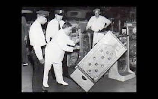LaGuardia pushing over the Bally's Bumper pinball machine.