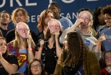 Supporters hold up Bernie Sanders masks while waiting for Democratic presidential candidate, Sen. Bernie Sanders, I-Vt. to speak at the Kansas City Convention Center for a campaign event in Kansas City, Mo., Wednesday, Feb. 24, 2016. (AP Photo/Jacquelyn Martin)