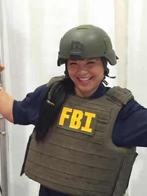 Jenny tries on an FBI vest at a training.
