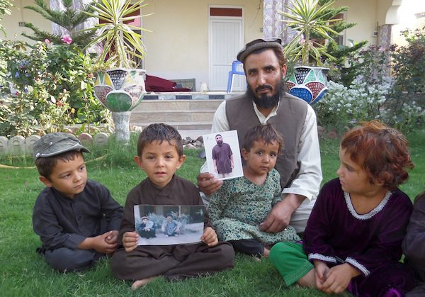 Fazel Karim holds a picture of his brother, who was recently released from the Guantanamo Bay detention center.