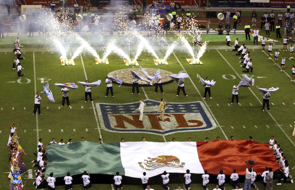 "FILE - In this Oct. 2, 2005, file photo, performers are shown prior to the start of a regular season NFL game between the Arizona Cardinals and San Francisco 49ers at Azteca Stadium in Mexico City, Mexico. Eleven years after the network telecast an NFL game from Mexico City, it will do so again when the Raiders ""host"" the Texans on Monday night. (AP Photo/Marco Ugargte, File)"