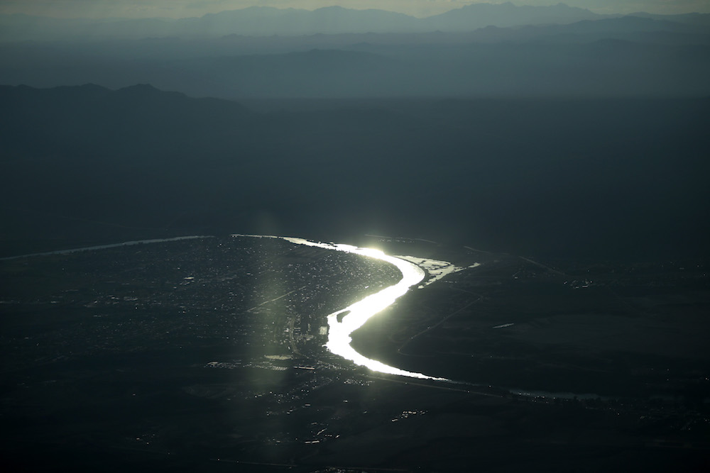 In this Wednesday, Oct. 14, 2015 photo, the Colorado River runs near Laughlin, Calif. The river sustains 40 million people and farms 5½ million acres. (AP Photo/Jae C. Hong)
