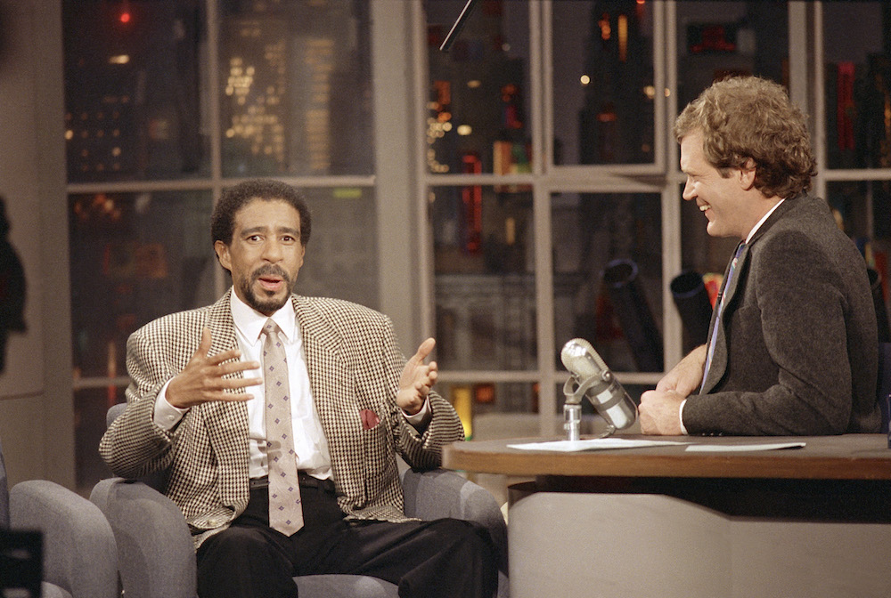 "Comedian Richard Pryor gesture while sharing a laugh with David Letterman during the ""David Letterman Show"" in New York Thursday, January 15, 1987. Pryor is starring in the film ""Critical Condition."" (AP Photo/Susan Ragan)"