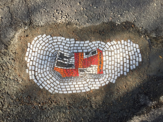 """From """"Witty Mosaics Offer a Beautiful Solution to the Pothole Problem"""" by Siobhan Phillips"""
