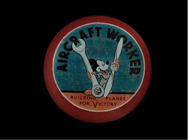 WWII aircraft worker's pin featuring Mickey Mouse, from the Lockheed Martin Aircraft Plant in Burbank, CA.