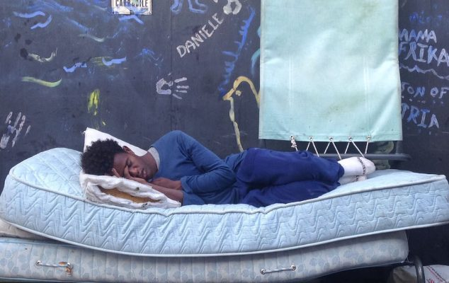 A refugee rests in the camp of Via Cupa in Rome, July 27, 2016. Photo courtesy of Viola de Andrade Piroli.