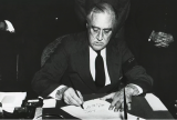 President Franklin D. Roosevelt signing the declaration of war against Japan, Dec. 8, 1941. Courtesy of the National Archives and Records Administration.