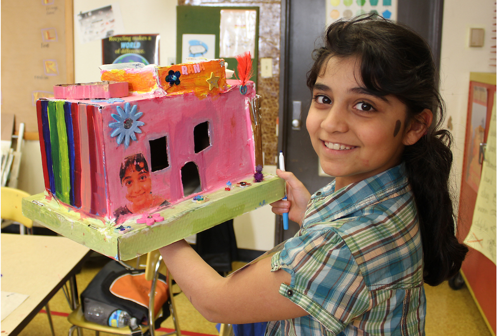"Students in a Baltimore program for refugee youth made models of their personal sanctuaries. Rana, from Iraq, built a house. ""A sanctuary represents peace,"" she wrote.. ""The coolest part of my sanctuary is the four seasons."" Photo by Ben Hamburger."