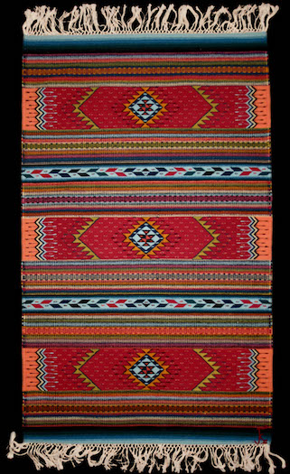 Traditional tapate—belonging to the author—that was woven by Fidel Cruz Lazo of Teotitlán del Valle, who colors his yarns with only cochineal and other local natural dyes. Courtesy of Amy Butler Greenfield.