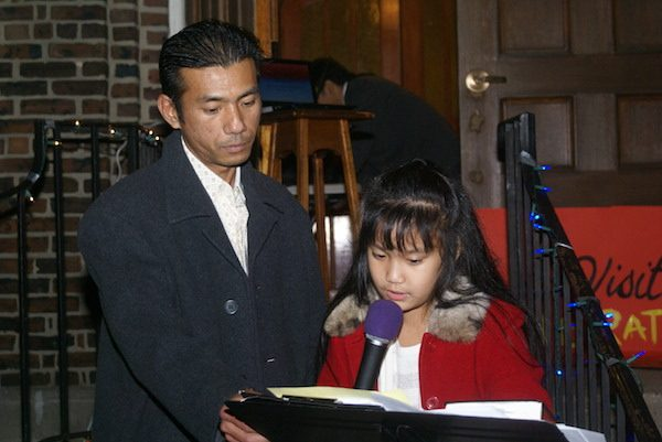 Harry Pangemanan, after 4 months in detention and many months in sanctuary, with his daughter Jocelyn on the steps of the Reformed Church of Highland Park. Courtesy of Reformed Church of Highland Park.