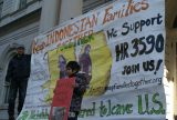 An Indonesian man and child brought attention to the plight of Indonesian Christians on the steps of New York's City Hall in December 2011. Courtesy of Reformed Church of Highland Park.