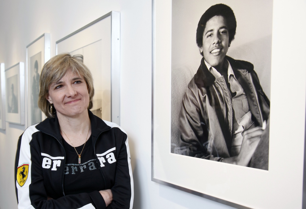 "In this 2009 image, photographer Lisa Jack poses with her photos of ""Barack Obama The Freshman"" taken during the year he lived in Pasadena and attended Occidental College. Photo by Damian Dovarganes/Associated Press."