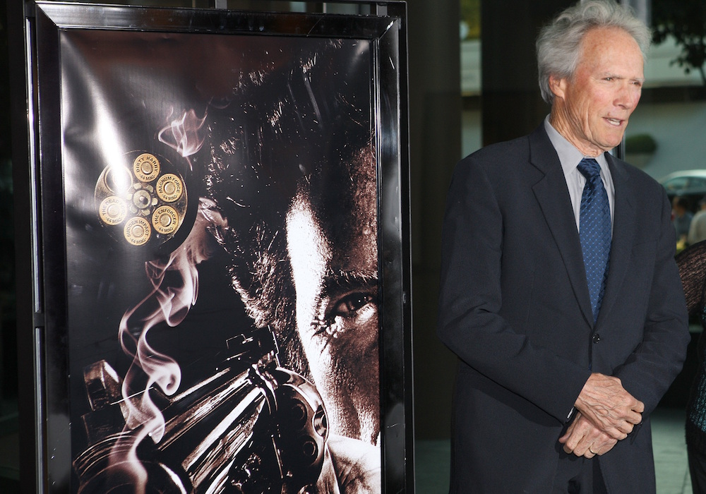 """Actor and director Clint Eastwood arrives at a screening for the DVD box set release of the """"Dirty Harry"""" film franchise in 2008 in Los Angeles. Photo by Chris Weeks/Associated Press."""