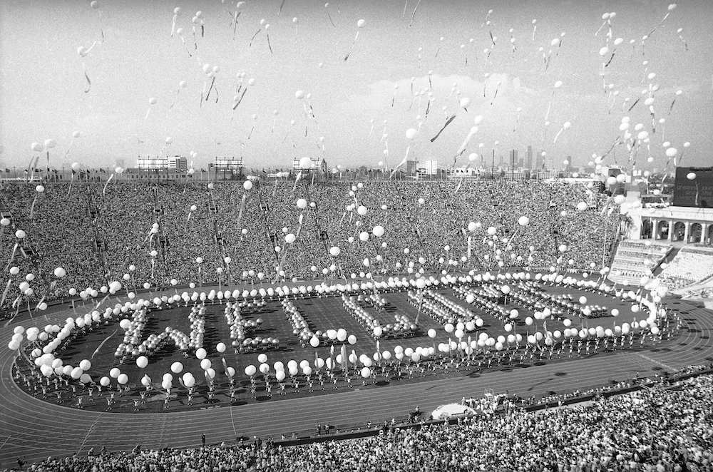 More than 1,000 five-foot helium balloons pulling colorful streamers float upward during the opening ceremonies of the 1984 Summer Olympics at the Los Angeles Memorial Coliseum. Photo by Dave Tenenbaum/Associated Press.