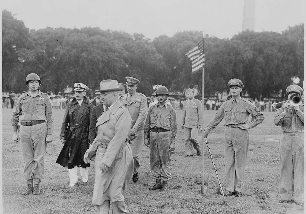President Harry S. Truman reviews the Japanese-American 442nd Regimental Combat Team in Washington, D.C. on July 15, 1946. Photo by Abby Rowe/National Archives and Records Administration.