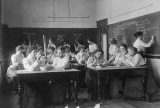 Group of young women performing atmospheric pressure experiments while studying science in normal school, Washington, D.C. By Frances Benjamin Johnston, 1899. Courtesy of Library of Congress.