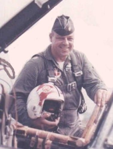 The author's father near the cockpit of his F4. During the Cuban Missile Crisis, he flew an F102. Courtesy of Karen Bjorneby.