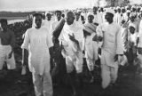 Mahatma Gandhi gives the last instructions on the beach near Dandi, India, as he and his supporters get ready to demonstrate at the Salt Satyagraha (Salt March) in which he and demonstrators marched 241 miles to the sea to make their own salt, April 6, 1930. Britain responded by arresting over 60,000 people. Photo by W. Bossard/Associated Press.