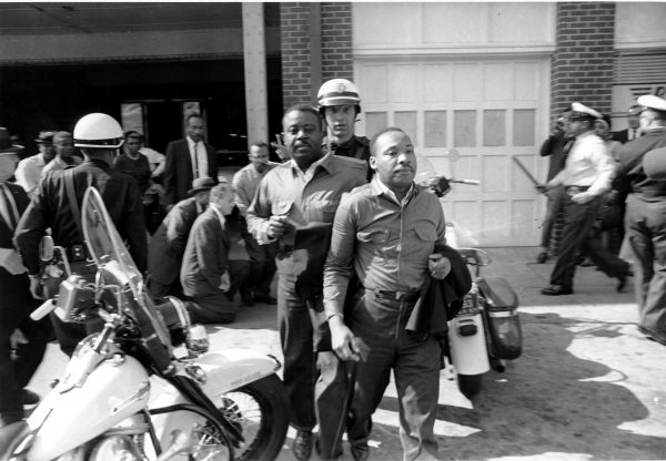 Rev. Ralph Abernathy, left, and Rev. Martin Luther King Jr., right, are taken by a policeman as they led a line of demonstrators into the business section of Birmingham, Ala., on April 12, 1963. Courtesy of Associated Press.