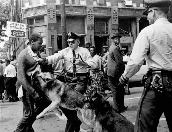 In this iconic image published in The New York Times on May 4, 1963, a 17-year-old high school student is attacked by a police dog in Birmingham, Ala.  Photo by Bill Hudson/Associated Press.