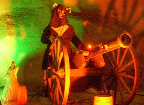 "Inside the Silver Dollar City dark ride Fire in the Hole, a ""Bald Knobber"" blasts riders with his cannon while a coyote eerily howls close by. Courtesy of Creative Commons."