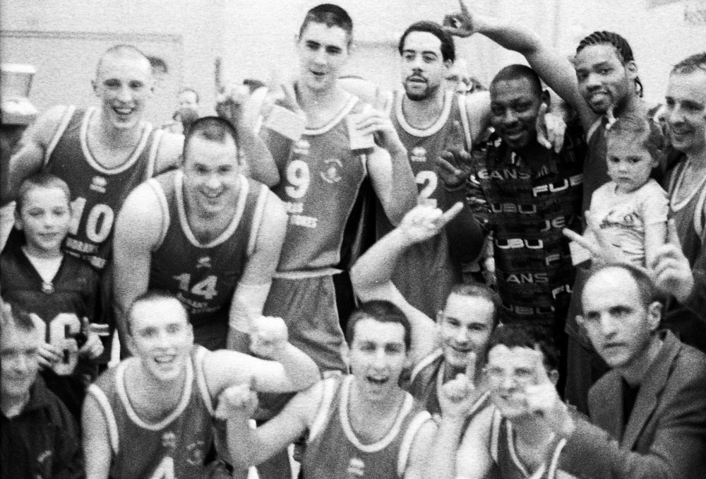 Rus Bradburd with the Tralee Tigers after victory over Belfast for the 2004 Irish Professional Basketball title. Photo courtesy of Michael Gaylord James.