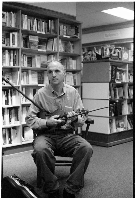 Rus Bradburd playing fiddle at City Lights Books in Iowa City, Iowa in 2007. Photo courtesy of Michael Gaylord James.