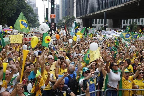 Demonstrators gather in São Paulo to demand the impeachment of Brazil's then-President Dilma Rousseff in March 2016. Rousseff was eventually toppled over alleged fiscal mismanagement. Photo by Andre Penner/Associated Press.