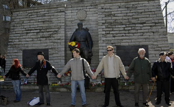 Protesters stand around the statue of a Red Army soldier to prevent the Estonian government's plan to move the Soviet-era monument honoring in Tallinn, April 22, 2007. The statue was subsequently removed, and Russian hackers are suspected of having temporarily disabled Estonia's access to the internet with denial-of-service attacks in retaliation. Photo by NIPA, Timur Nisametdinov/Associated Press.