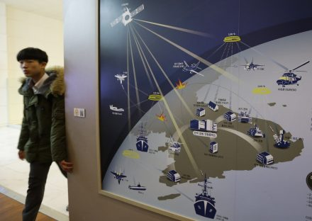 A South Korean student walks by a picture, which shows how cyberwarfare will be waged in the Korean Peninsula if Korean War takes place in the future, at Korea War Memorial Museum in Seoul, South Korea, Dec. 2014. Photo by Ahn Young-joon/Associated Press.