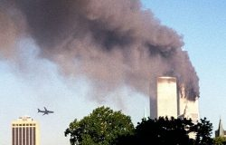 A hijacked plane carrying  scores of passengers approaches New York's World Trade Center moments before it struck the tower at left, as seen from downtown Brooklyn, Tuesday, Sept. 11, 2001. Access to the internet and flight simulators made it possible for terrorists to topple the World Trade Center, hit the Pentagon, and cause billions of dollars in damages. Photo by William Kratzke/Associated Press.