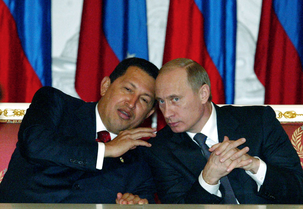Russia's President Vladimir Putin, right, and Venezuela's President Hugo Chavez talk during a meeting in Moscow's Kremlin in 2004. Photo by Mikhail Metzel/Associated Press.