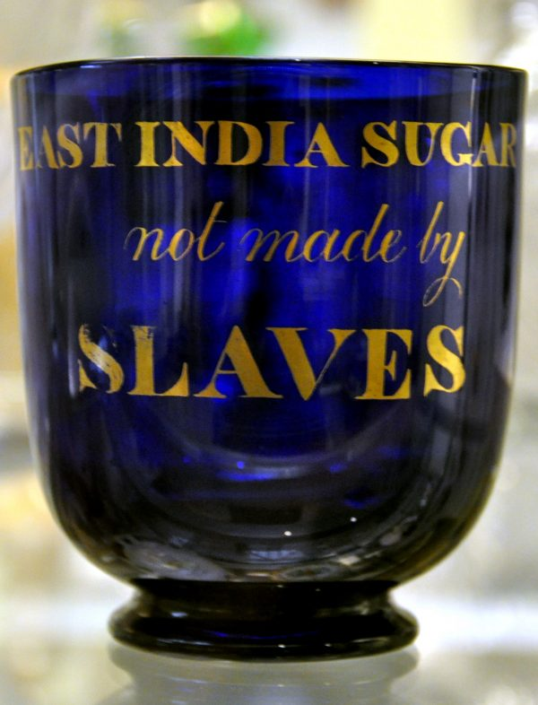 "Blue glass sugar bowl inscribed in gilt, ""East India Sugar Not Made By Slaves,"" c. 1820-1830. Image courtesy of The British Museum."