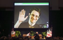 Edward Snowden appears via video feed from Moscow for a meeting of the American Civil Liberties Union (ACLU) in Hawaii, Feb. 2015. Photo by Marco Garcia/Associated Press.