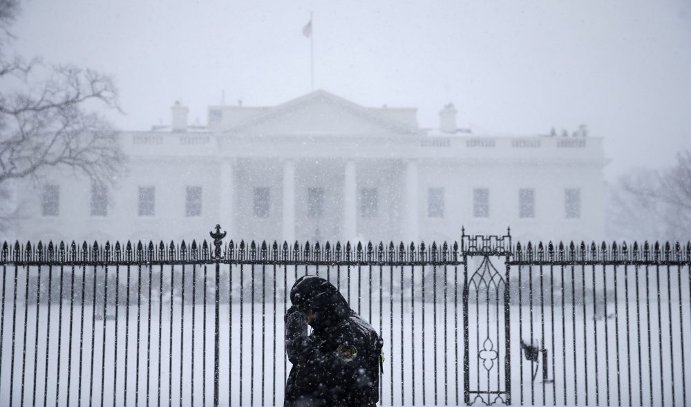 A Uniformed Secret Service officer patrols during blizzard conditions in front of the White House in Washington, D.C., Jan. 2016. Photo by Gerald Herbert/Associated Press.
