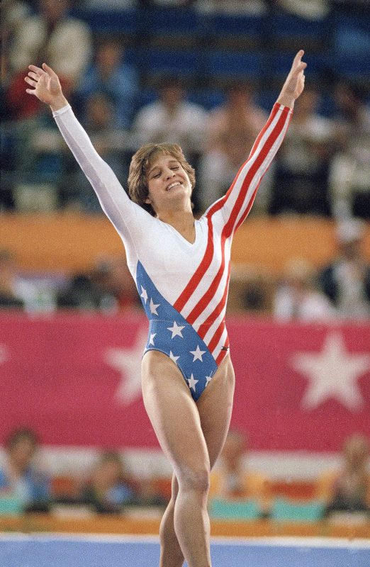 Mary Lou Retton celebrates her balance beam score at the 1984 Olympic Games in Los Angeles. Retton, 16, became the first American woman ever to win an individual Olympic gold medal in gymnastics. Photo by Lionel Cironneau/Associated Press.