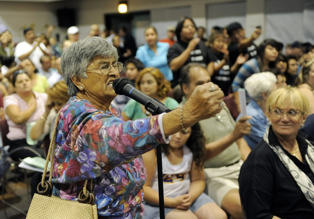 Carmen Bella, 76, a resident of Bell, Calif. yells at city council members during a city council meeting addressing city leaders' pay in July 2010. Photo by Chris Pizzello/Associated Press.