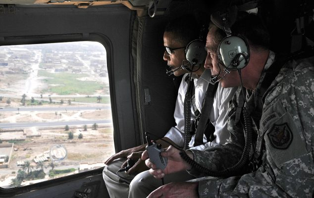 In this July 21, 2008 photo released by the U.S. army, then-U.S. presidential candidate Barack Obama, left, and then-top U.S. military commander in Iraq, David Petraeus, ride inside a helicopter in Baghdad, Iraq. Photo by Ssg. Lorie Jewell, HO/Associated Press.