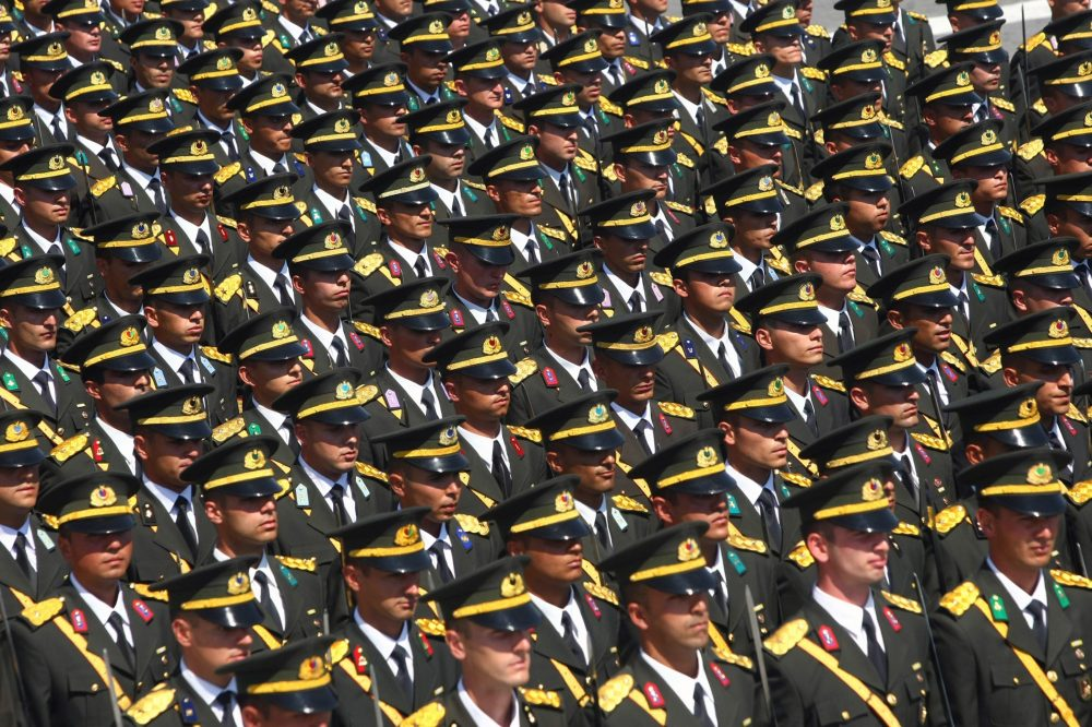 War College students march during the Victory Day celebrations in Ankara, Turkey, Aug. 2011. As some democracies struggle to preserve their legitimacy, or give way to authoritarian regimes, institutions like the military could benefit by gaining power. Photo by Associated Press.