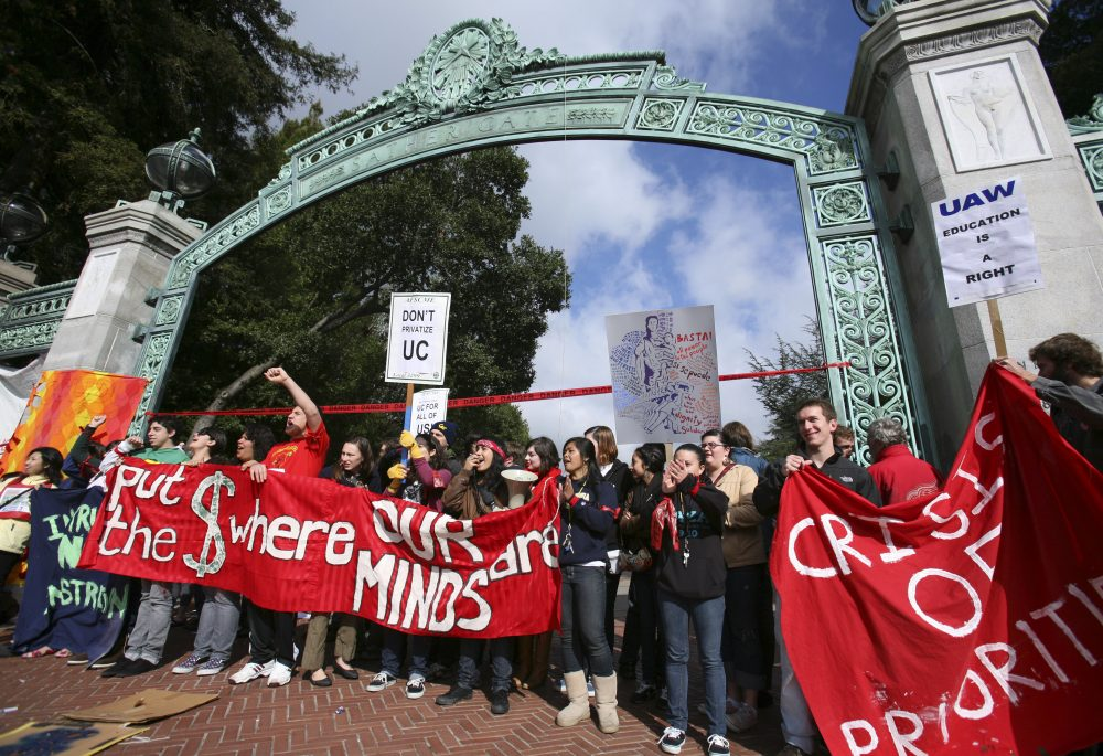Political partisans of many stripes love to scapegoat UC Berkeley. Students block Sather Gate on the campus during a protest on March 4, 2010. Photo by Ben Margot/Associated Press.