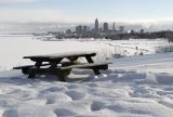 Snow surrounds a lone picnic table at Cleveland Lakefront State Park, Feb. 8, 2011. Photo by Mark Duncan/Associated Press.